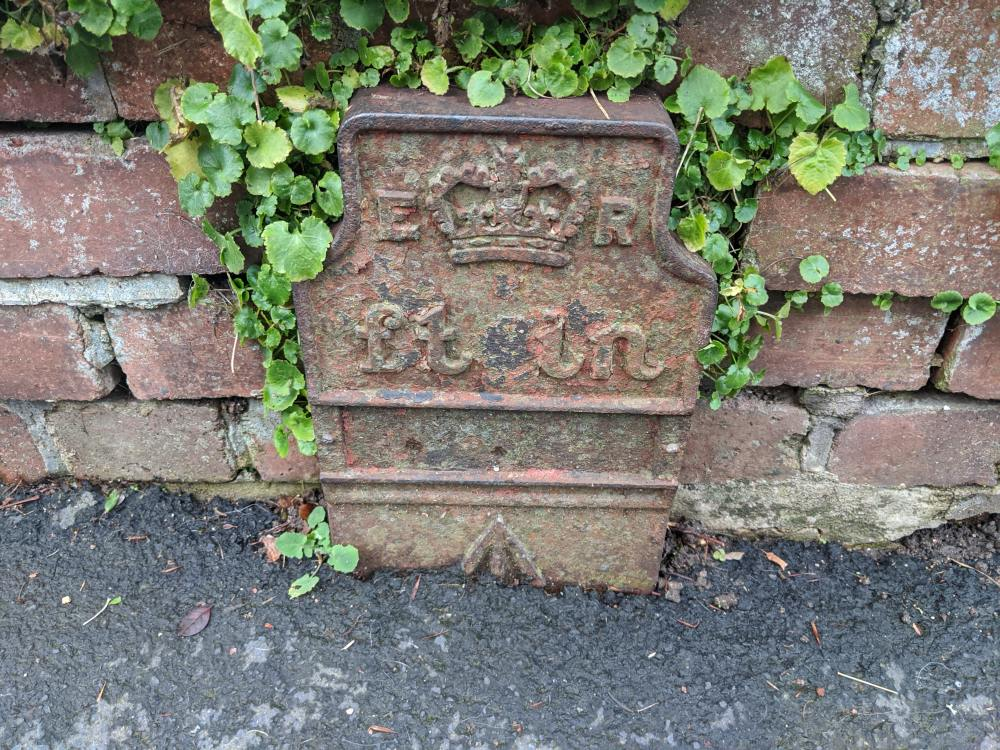 Telegraph cable marker post at 44 Court Street, Moretonhampstead by Dartefacts Dave Hamnett
