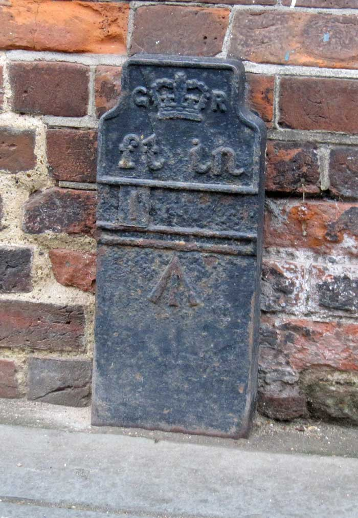 Telegraph cable marker post at 10 Palace Street, Canterbury, Kent by CHAS